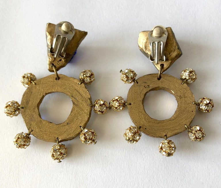 Glass mirror with glass nuggets and rhinestone earrings designed and created by Christian Lacroix for his 1987 Luxe Collection.  Earrings measure 2.75