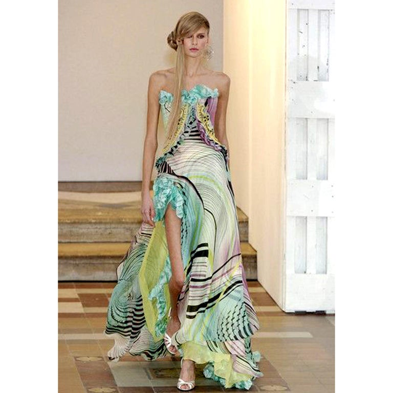 Feather light silk chiffon Christian Lacroix strapless  silk evening gown from Spring / Summer 2005.  This strapless dress has a dramatic thigh high slit and is in an abstract geometric print with swirls of of purple, blue, green, chartreuse and