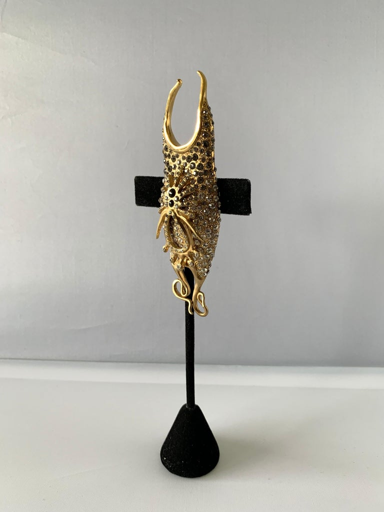Exquisite vintage Christian Lacroix jeweled three-dimensional brooch/pin comprised out of gilt metal