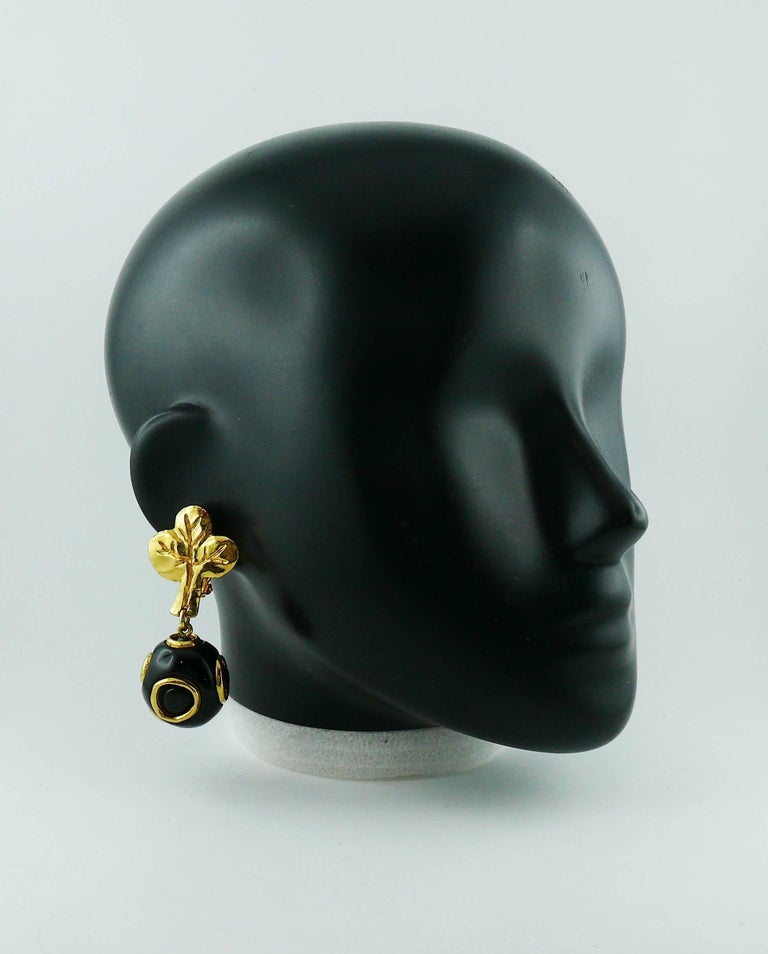 CHRISTIAN LACROIX vintage dangling earrings (clip-on) featuring an abstract gold toned tree top and a large black resin ball with geometric design.  Marked Christian Lacroix CL Made in France.  Indicative measurements : length approx. 6.5 cm (2.56