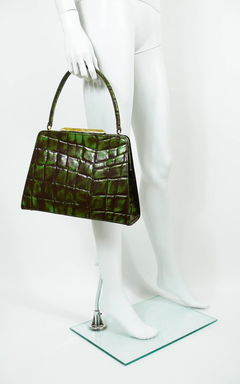 CHRISTIAN LACROIX vintage rare faux leather croc embossed framed handbag in vibrant green and brown colors.  This bag features : - Gold toned hardware. - Gorgeous gold toned textured clasp embossed CHRISTIAN LACROIX CL. - Yellow canvas lining. - One