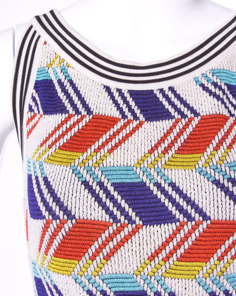 Amazing vintage Christian Lacroix body con knit dress with a colorful geometric design.  Details:  Unlined No Closure Marked Size: Medium Color: Orange/ Yellow/ Blue/ White Fabric: Knit Label: Christian Lacroix/ Paris  Measurements:  Bust: 32