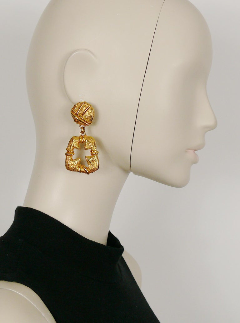 CHRISTIAN LACROIX vintage textured gold toned dangling earrings (clip-on) featuring a cut out cross.  Marked CHRISTIAN LACROIX E94 Made in France.  Indicative measurements : height approx. 6.5 cm (2.56 inches) / max. width approx 3 cm (1.18