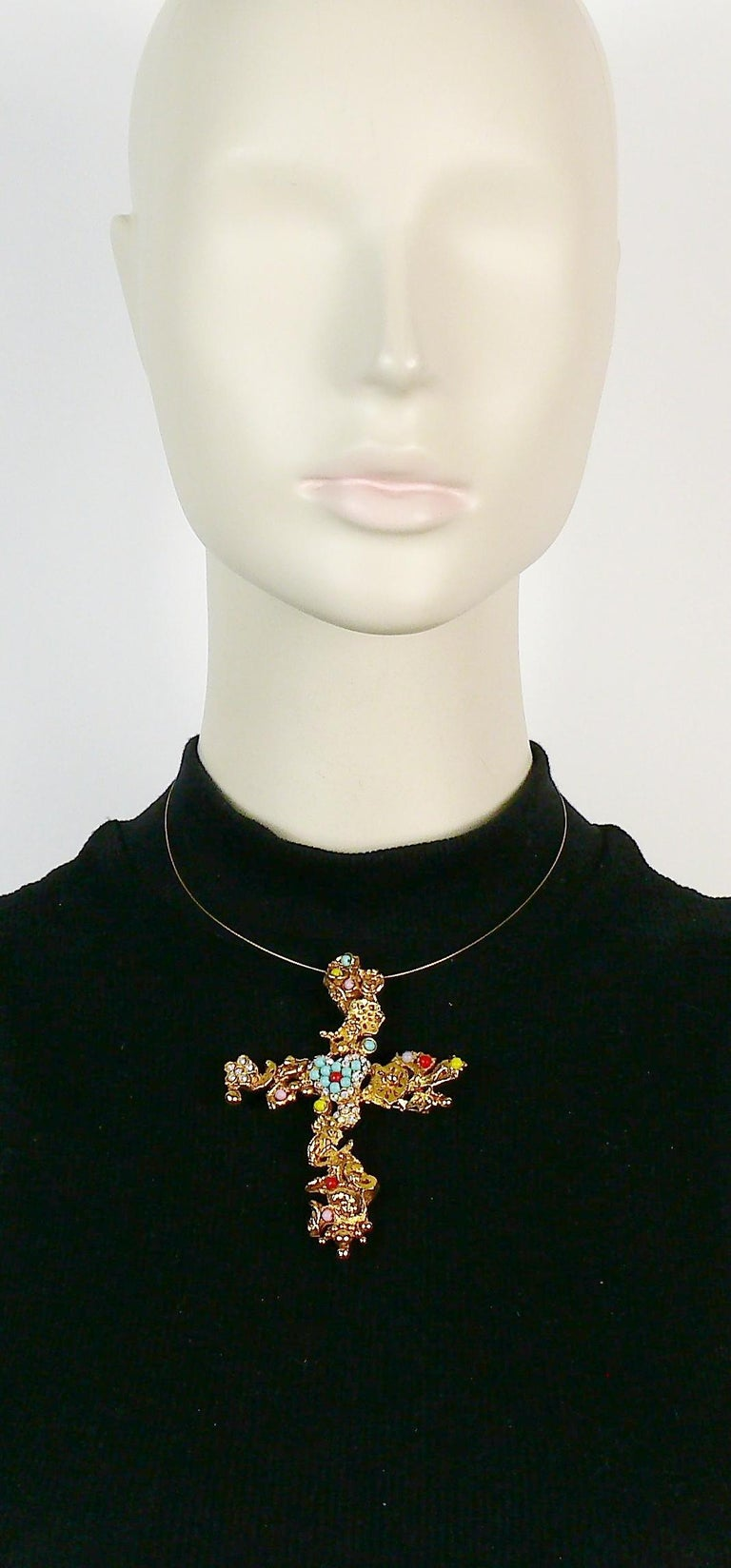 CHRISTIAN LACROIX vintage pendant necklace featuring a gold toned cross with intricate baroque pattern, crystals and colourful beads, cherub head at the bottom and CL logo.  Can be worn as a brooch.  Marked CHRISTIAN LACROIX CL Made in