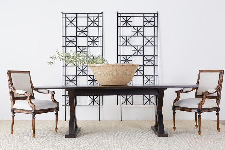 Chic Christian Liaigre for Holly Hunt modern courier farm or harvest dining table. Features an ebonized walnut finish and massive x form legs. Lovely profile with excellent joinery and craftsmanship. From an estate in Napa, CA.