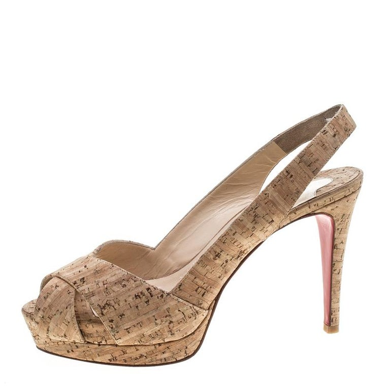 Every fashionista needs a pair of shoes as lovely as these slingback sandals from Christian Louboutin. They've been crafted from cork and designed with peep toes, slingbacks, and a set of 10 cm heels supported by platforms.  Includes: Original