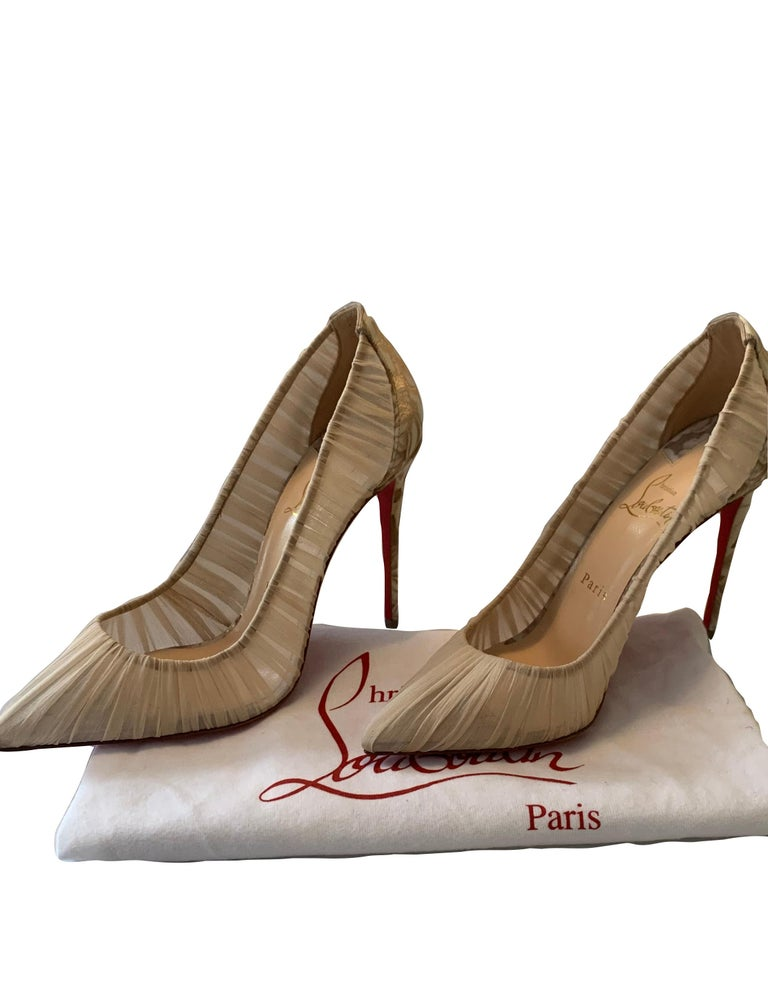 Christian Louboutin Beige Follie Draperia 100 High Heel Pumps sz 39.5.  Features rose design on back and heels of shoes.  Made In: Italy Color: Beige Materials: Chiffon Overall Condition: Like new condition.   Estimated Retail: $795 plus