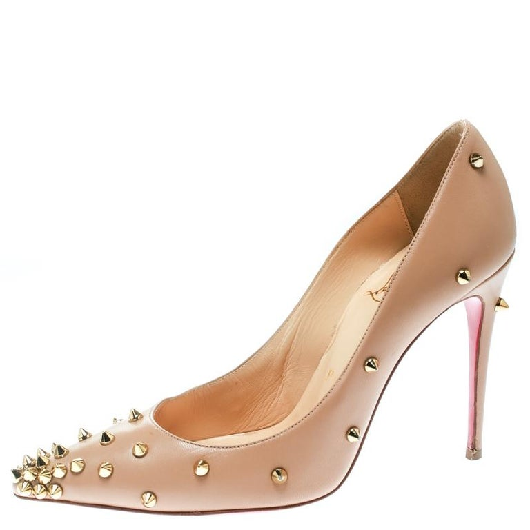 Think of high heels and Christian Louboutin is what comes to our minds. These exquisite and regal beige Degraspike pumps from the Parisian label are worth dying for. Crafted in leather, these pumps have stunning details like the pointed toes, smooth