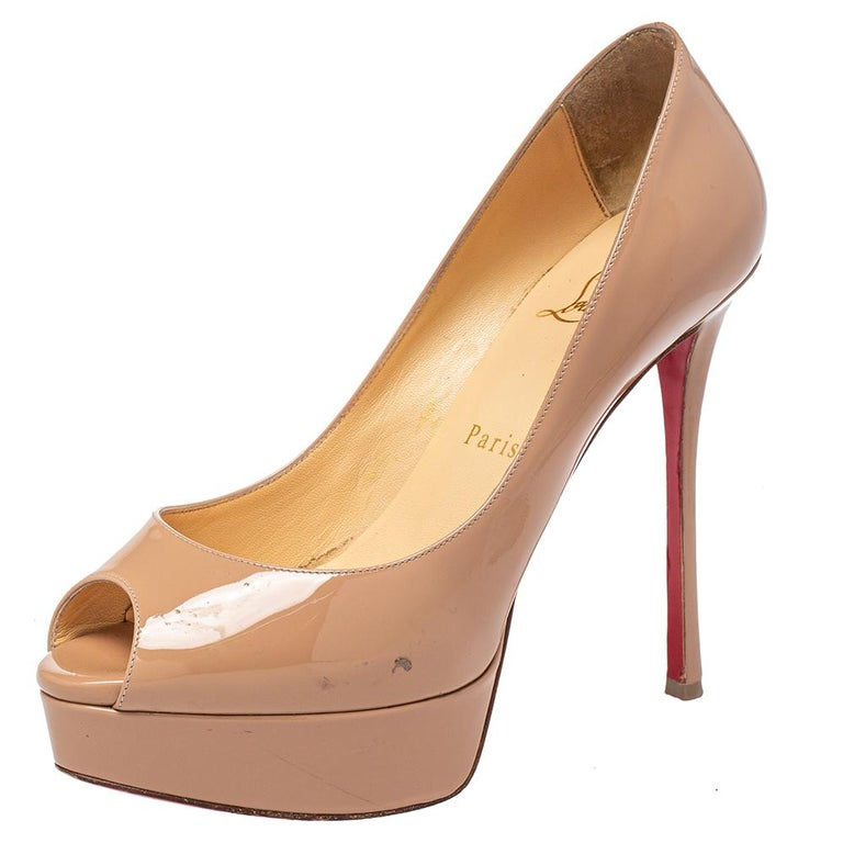 Strike a bold finish to your party outfit wearing these stunning Christian Louboutin Fetish pumps. Crafted from beige patent leather, they feature an impressive peep-toe silhouette to count on. The leather-lined insoles carry brand labeling and this