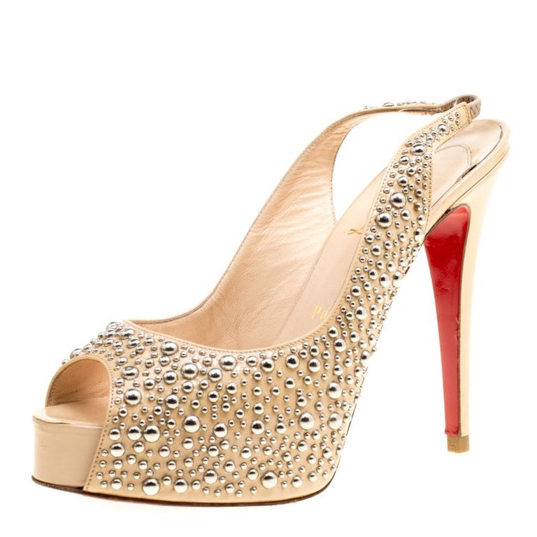 online retailer 6a3f9 a745a Christian Louboutin Beige Studded Patent Leather Star Prive Peep Toe  Slingback S
