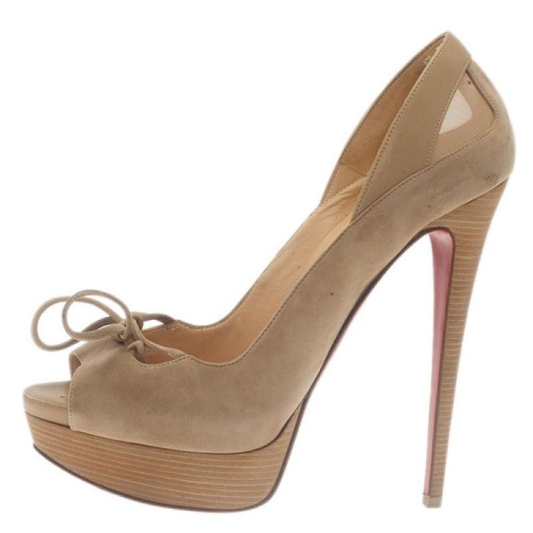 These Christian Louboutin Pumps will dazzle any look. Made from soft beige suede, they feature crepe bow accents on their peep toes, tonal leather with mesh insets on their backs and 15cm heels. They are leather lined with signature red