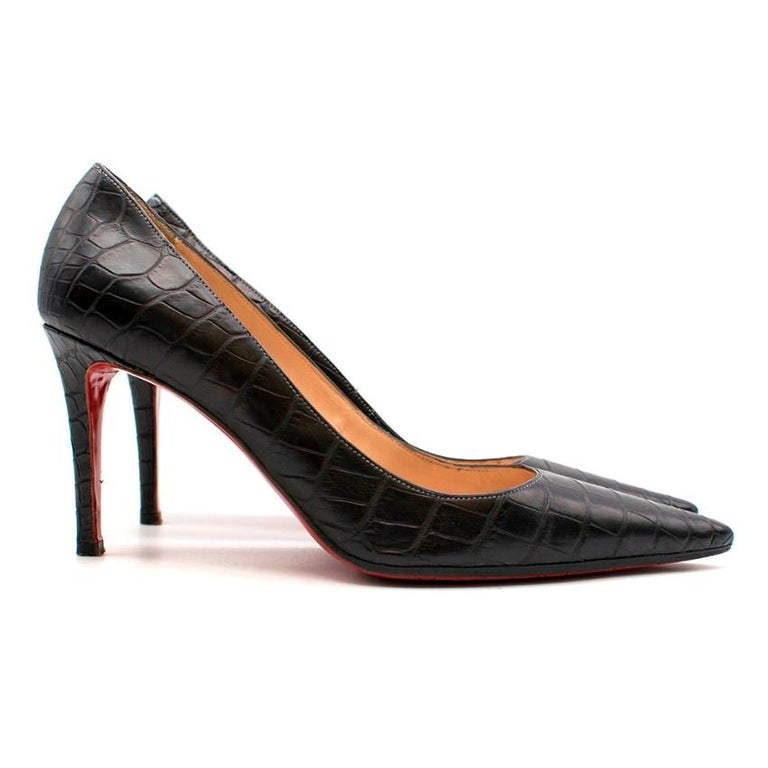 Christian Louboutin Black Crocodile Pointed Pumps  - Pointed toe - High heels - Classic red bottoms - Nude leather lining - Light grey contrast stitching  Material - Calf leather, crocodile embossed - Leather insole - Leather sole with rubber ball