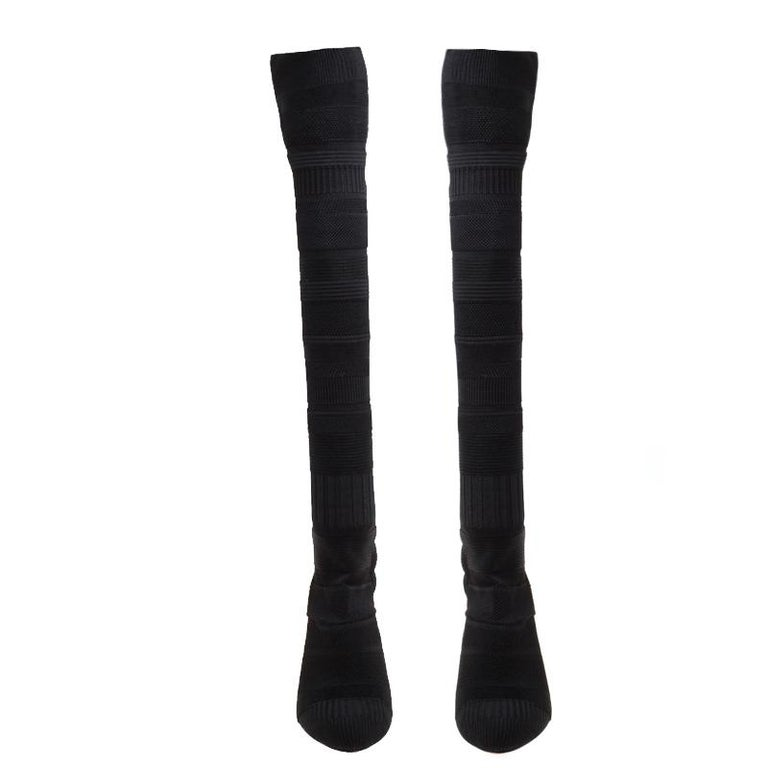 Christian Louboutin's Cheminetta boots define the power of modern women with utter grace. Crafted in black knit fabric, the pair is fashioned in a thigh-high style, which is sure to add a dramatic touch to your look. They have a sock-like silhouette
