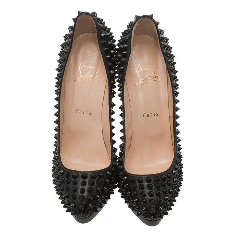 Set the night on fire as you walk in these seductively pumps by Christian Louboutin. They have been made from black leather and look enviously striking owing to the Alti spike detailing all over.  Includes: The Luxury Closet Packaging