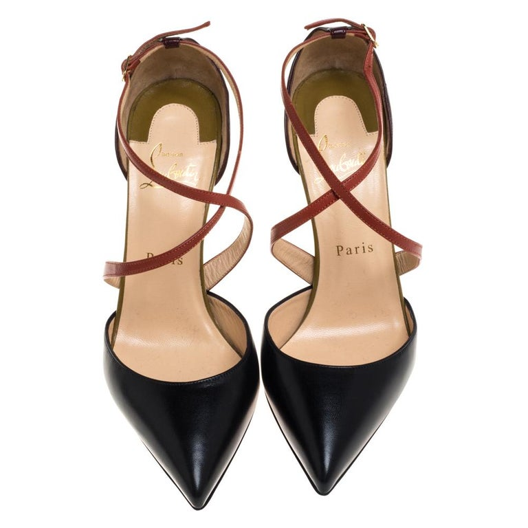 Let your feet do all the talking as you flaunt these fabulous sandals from Christian Louboutin. These leather pumps will make you look confident and uber-stylish. They feature pointed toes, crisscross straps on the vamps, and 11.5 cm heels. Wear