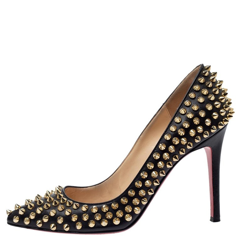 Dazzle everyone with these Louboutins by owning them today. Crafted from leather, these black Pigalle pumps carry a mesmerizing shape with pointed toes and 10 cm heels. Complete with gold-tone spikes all over and the signature red soles, this pair