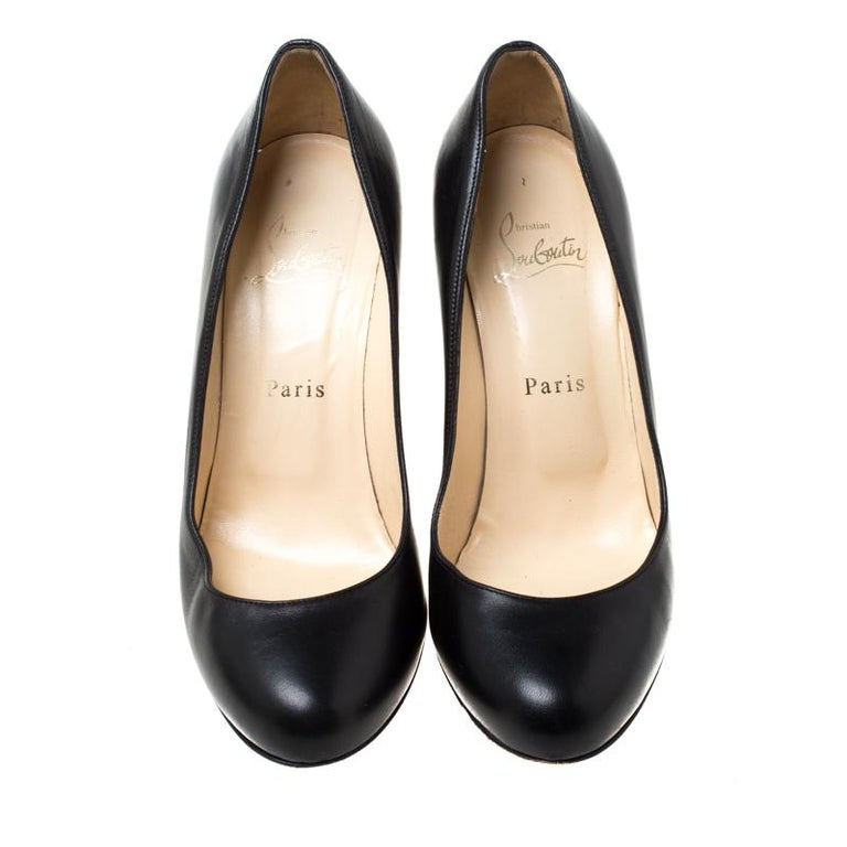 Crafted out of leather, these pumps are a charming add-on accessory that you absolutely need to own. A timeless design and enhanced comfort define these Christian Louboutin pumps. They feature round toes and wedge heels.  Includes: The Luxury Closet