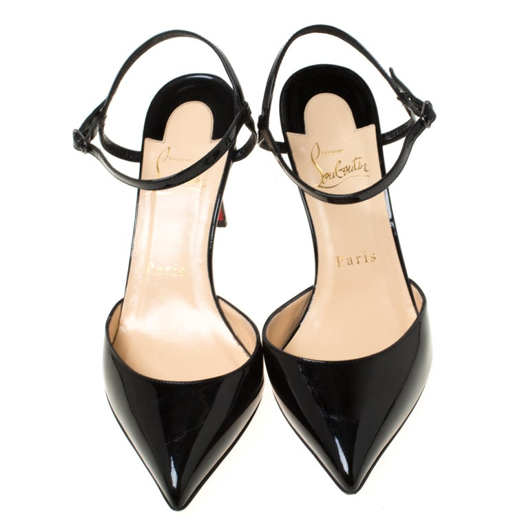 These patent leather sandals are a high-end fashion item that you need to own now. These stylish sandals by Christian Louboutin feature covered pointed toes, buckled ankle straps and 8.5 cm heels. These black sandals are perfect for the fashionista