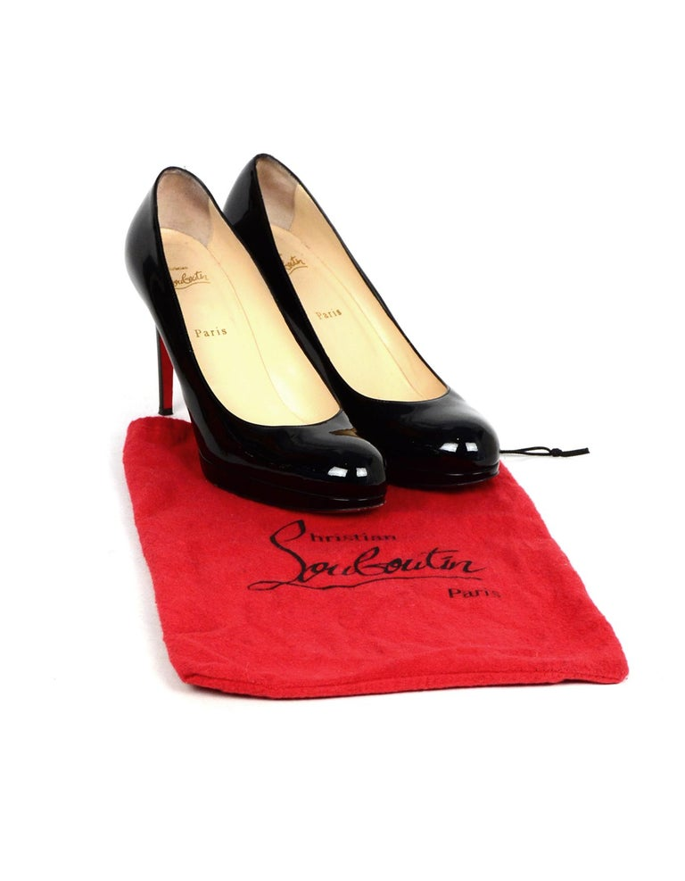 Christian Louboutin Black Patent Leather Simple Pump Sz 41 W/ DB  Made In: Italy Color: Black Materials: Patent leather Closure/Opening: Slide on Overall Condition: Excellent pre-owned condition with exception of some scuffing in patent leather