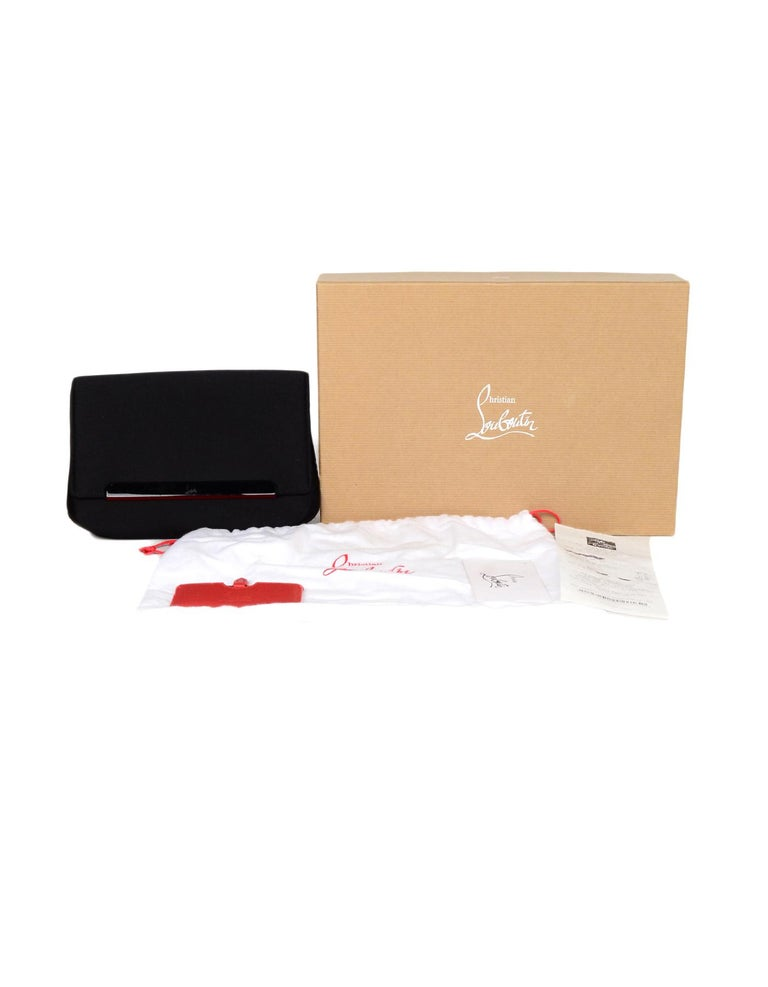 Christian Louboutin Black Satin Small Rougissime Clutch Bag  Made In: Italy Color: Black Hardware: Black, red Materials: Satin, metal Lining: Red satin  Closure/Opening: Flap top with magnetic closure Exterior Pockets: Rear magnetic pocket Interior