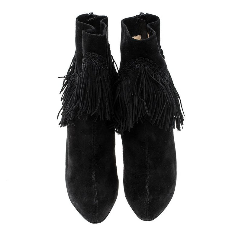 Add an instant touch of glam and fun style to your party looks with these stunning Christian Louboutin Rom platform ankle boots. Constructed in black suede material, these boots are made special with heavy fringe accents all around the ankle which
