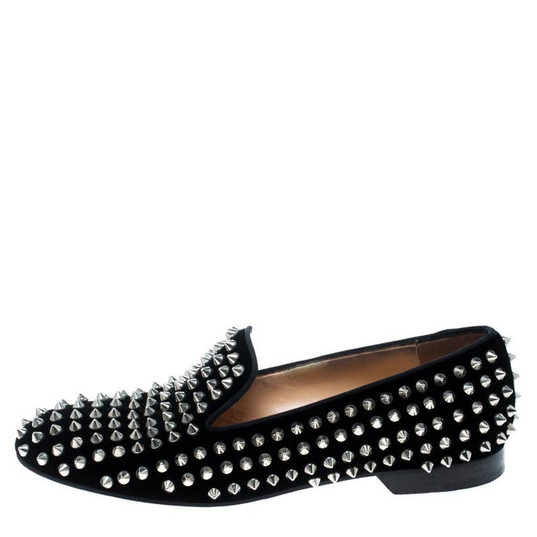Add some edge to your look with this pair of Christian Louboutin Rollerboy Spike flats. Made from black velvet, their sophisticated and exotic look is coupled with matching spikes all over the shoes. Lined with beige leather, these flats feature low