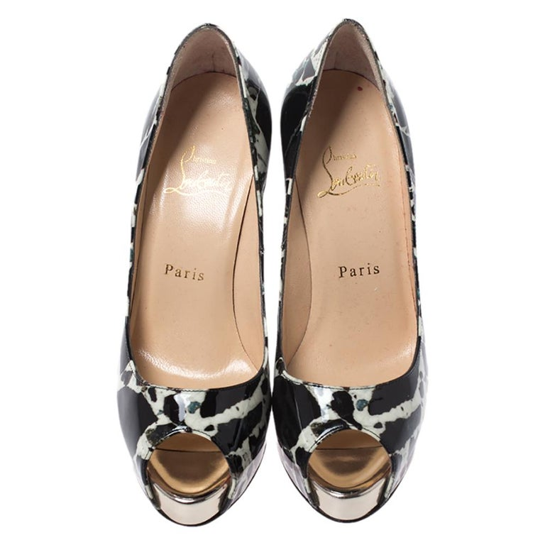 Dazzle everyone with these Louboutins by owning them today. Crafted from patent leather, these black-white printed peep-toe pumps carry a mesmerizing shape with 11.5 cm heels. They are lined with leather and come with the signature red soles. This