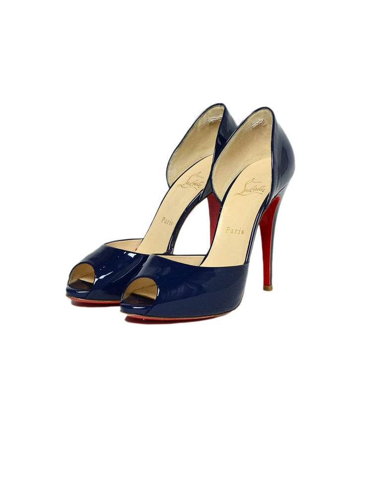 Christian Louboutin Madame Claude 120 Patent Open Toe Pumps sz 39.5 Made In: Italy Color: Navy blue Materials: Patent leather Closure/Opening: Slide on Overall Condition: Very good pre-owned condition, with light wear to insoles and soles Estimated