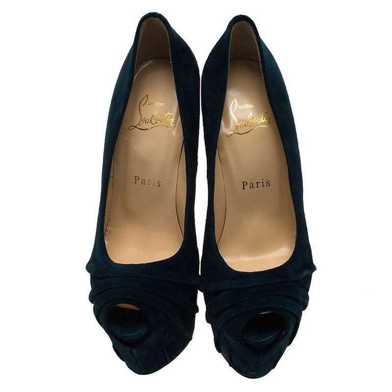 Made distinctive by their ruched detailing on the vamp, these Christian Louboutins have soft suede uppers. In addition to covered tapering heels, they have concealed platforms for an innovative vamp. They feature a crescent-shaped peep toe design