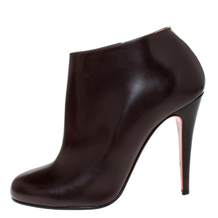 These stylish Christian Louboutin ankle booties are absolute closet essentials. Crafted from quality leather, they come in a lovely shade of brown. They are styled with round toes, side zip closures, 11 cm heels and the signature red soles. They are