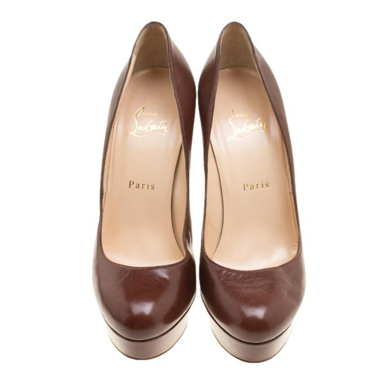 This pair of pumps by Christian Louboutin made in leather are fitting for an evening outing. Beautifully designed, this pair of pumps feature a leather lined insides with a 13.5 cm high heel and 3 cm platform.  Includes: The Luxury Closet