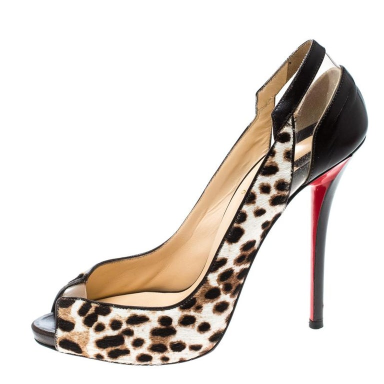 Add these edgy Christian Louboutin Technicatina pumps to make any outfit pop. They are crafted from brown pony hair into a peep-toe style and is adorned with a leopard print all over the exterior. They feature black leather and PVC panel detailing