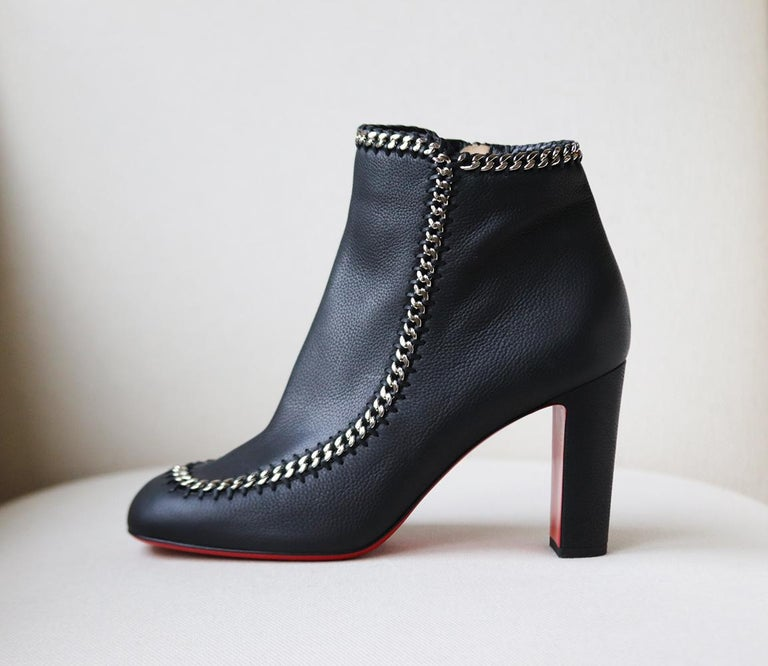 Christian Louboutin's pair feel darkly glamorous thanks to the glistening chain-trimming detail along the boot, they've been made in Italy from black leather and set on a sole lacquered in signature red. Rubber eel measures approximately 85mm/ 3.5