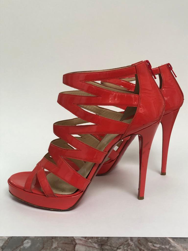CHRISTIAN LOUBOUTIN Coral Patent cage bootie In Good Condition For Sale In New York, NY
