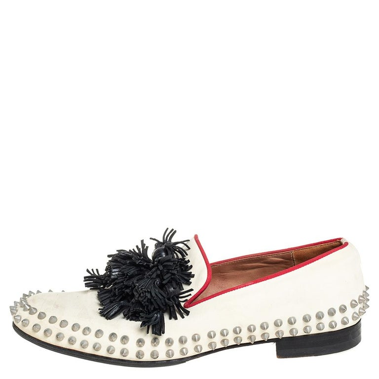 The distinctive aesthetics that these loafers carry are the exemplar of Christian Louboutin's brilliant craftsmanship. They are made from leather and adorned with tassels and studs. Style them with cropped pants or trousers for a chic