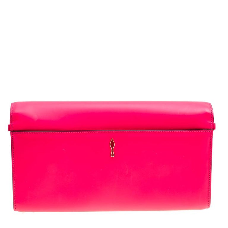 b085d6fe72 Sling on this glossy and effortless Riviera clutch from Christian Louboutin.  Crafted from fluorescent pink