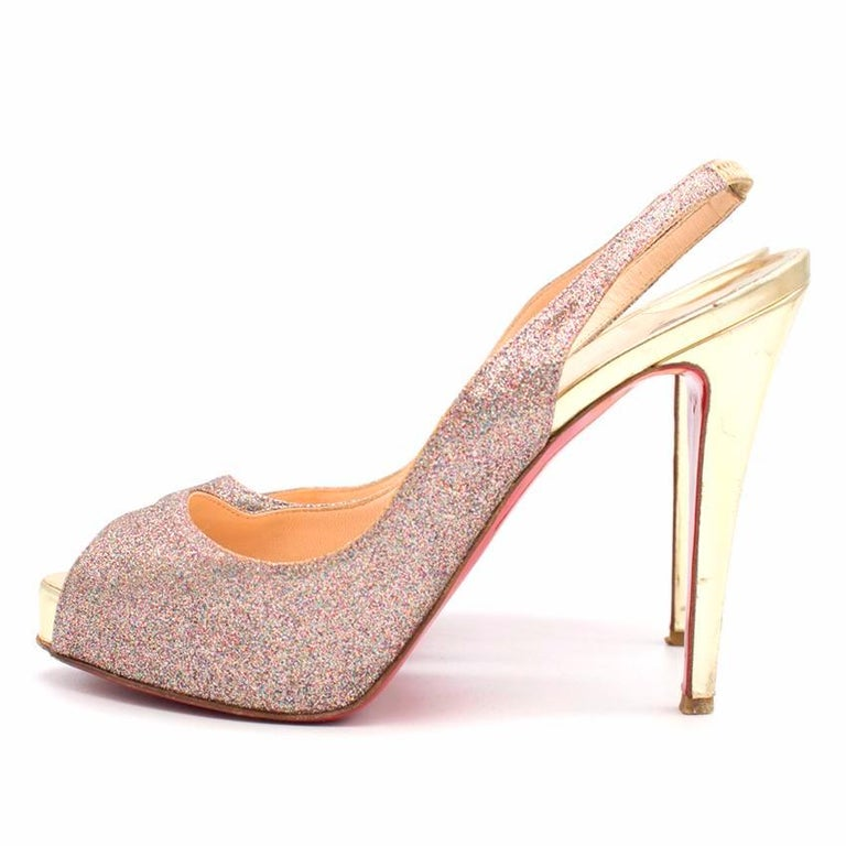 Christian Louboutin glitter numero prive peep toe pumps.  Made in France.   Features stylish peep toe and slingback.  Includes 1/2 inch platform and a four 1/2 inch stiletto.   Fabric: multi- coloured glitter/gold metallic leather.   Please note,