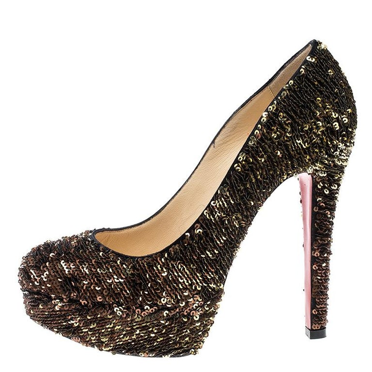 Every shoe collection needs a pair of pumps as enchanting as this one. These Christian Louboutin beauties are covered in sequins and styled with platforms, 12.5 cm heels, and the signature red soles. Add these pumps to your closet today and flaunt