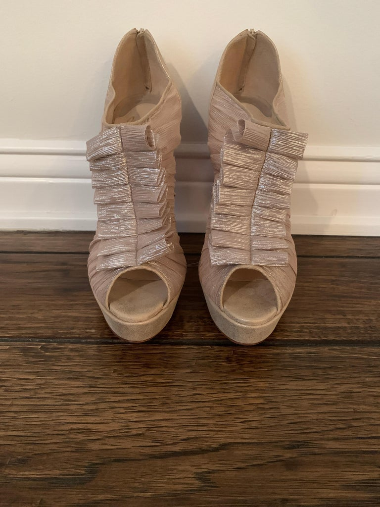 Christian Louboutin Gold, Silk, Ruffle Stiletto Heels Never Been Worn. No Signs of wear on the soles Heel Height 4.75inches  Size 40  Retail $1295