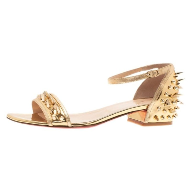 check out d77b1 eda0e Christian Louboutin Gold Spiked Leather Druide Sandals Size 38