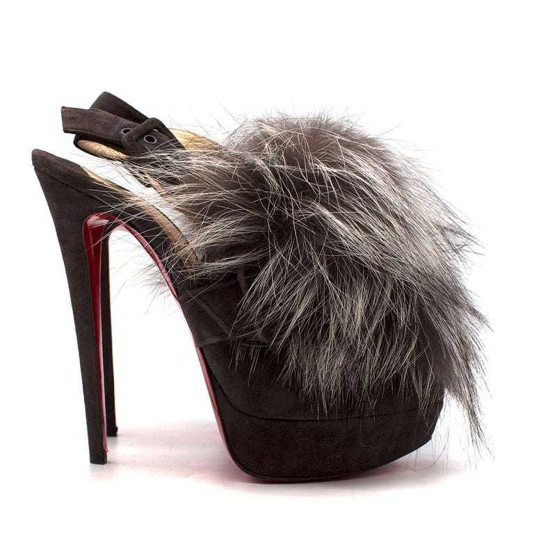 Christian Louboutin Grey Fox Fur Splash Slingback Heels  -Grey suede platform heels -Slingback ankle straps with buckle closure -Buckle detailing at the toe -Peep toe -Fox fur panel at the front  Please note, these items are pre-owned and may show