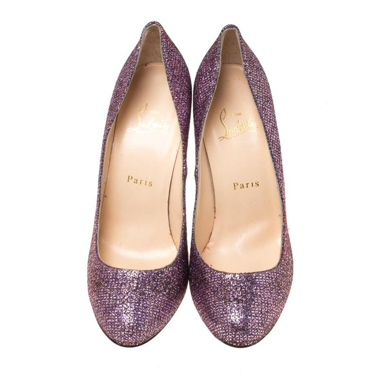 Feel glamorous every time you slip into this glitzy pair by Christian Louboutin. Covered in lavender glitter and balanced on 11 cm heels, these pumps will be a winner with all your well-tailored outfits. They are finished with the signature red on