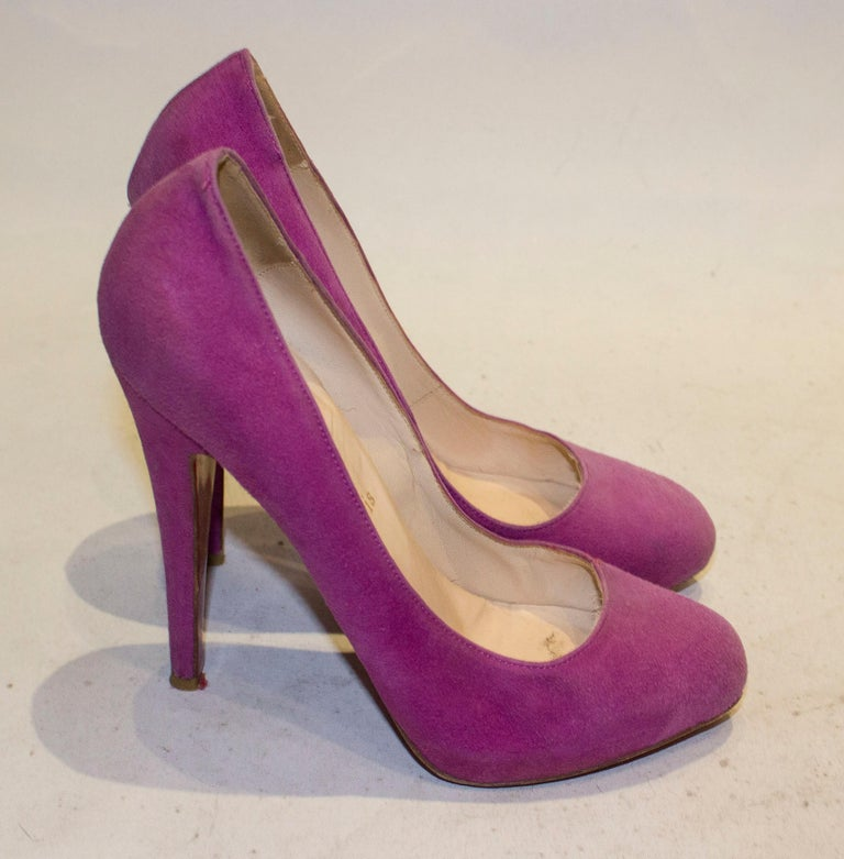 A pretty pair of lilac suede heels by Christian Louboutin. The shoes have a hidden platform and are marked size 38 1'2 , height 5 1/2''