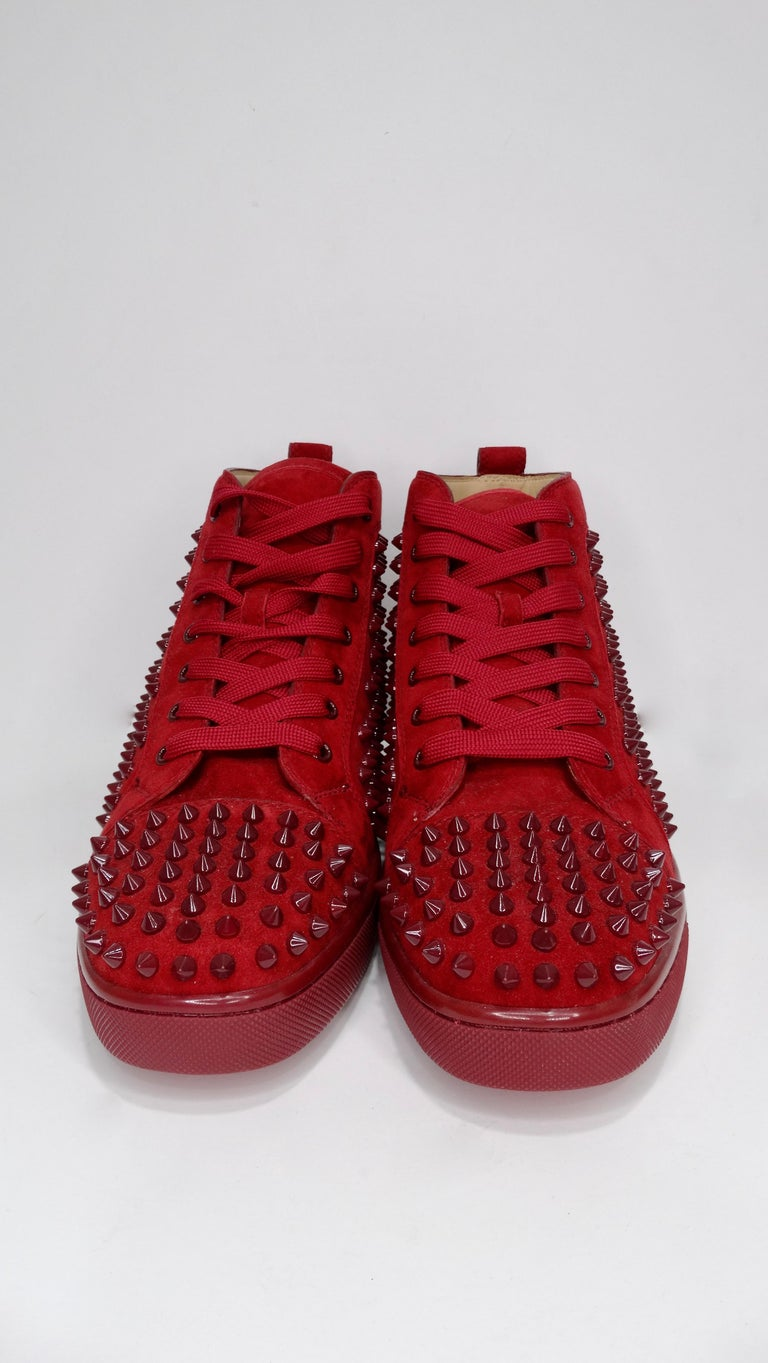 Elevate your look with these show stopping sneakers. Featuring a deep red suede and spikes throughout, these sneakers were originally created in 2009 and have had multiple variations and styles since then, including these from 2014. Pair with black