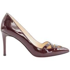 CHRISTIAN LOUBOUTIN Manue dark burgundy patent cross strap pointy pumps EU37 US7