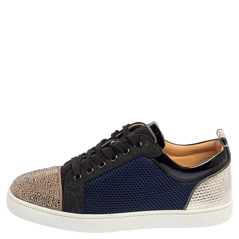 Christian Louboutin adds a statement look to these sneakers. They are crafted from a mix of materials, detailed with embellishments, and secured with laces. The red soles of these low-top Louis Junior sneakers will highlight every step you