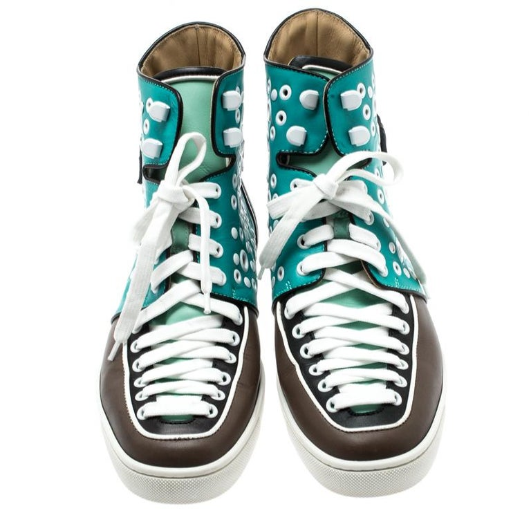 How chic and stylish are these Alfibully sneakers from Christian Louboutin! Crafted from multicolor leather, they feature round toes and lace-ups on the vamps. They have been styled with multiple white eyelets and buckled straps on the counters and