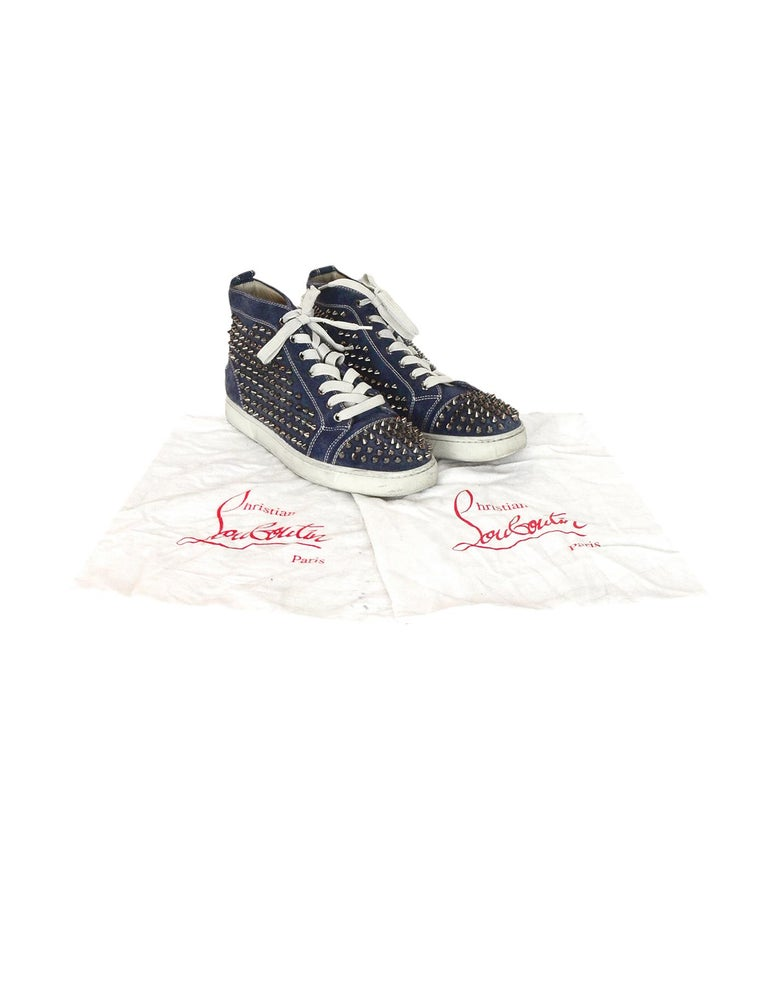 Christian Louboutin Navy Suede Louis Spiked Hi Top Sneakers Sz 40.5 W/ 2 DB  Made In: Italy Color: Navy, off white, gunmetal  Hardware: Gunmetal  Materials: Suede, metal Closure/Opening: Lace up front  Overall Condition: Good pre-owned condition