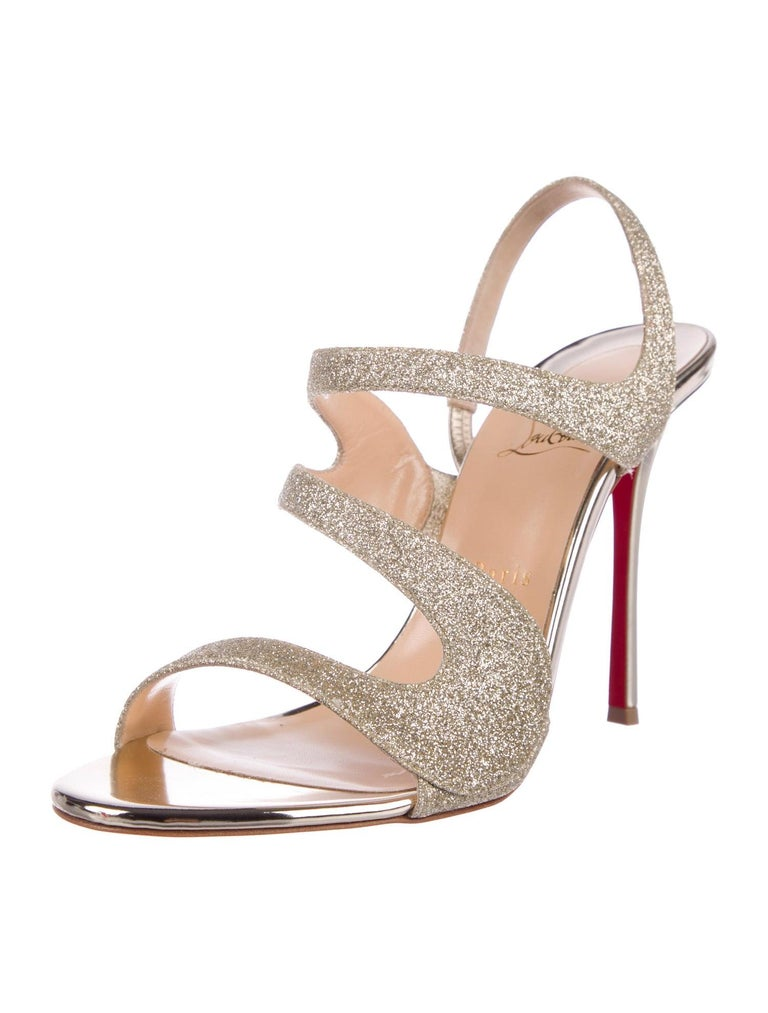 Christian Louboutin NEW Gold Glitter Strappy Sandals Pumps Heels in Box  Size IT 41 Leather Glitter Slip on Made in Italy Heel height 4.5