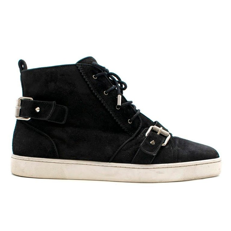 Christian Louboutin Black Suede High-top Strap Trainers.  - Black suede Nono Strap - Intricate details in a blend of high-top sneaker and Chukka boot.  - White rubber outsole,  - Signature Louboutin striated buckles, studded straps and pinking